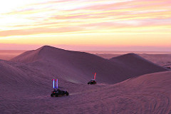Imperial Sand dunes at dusk while ohvs drift into the night