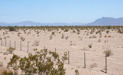 Palen project area in the desert with wire fence in seemingly hot sunny day