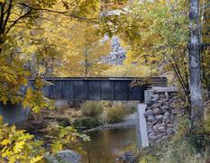 bizz johnson trail bridge over water in fall foliage
