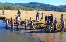 Lassen County Staff members and children clean up river