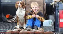 Boy hunting with his dog. Photo by Kari Boyd-Peark, BLM.