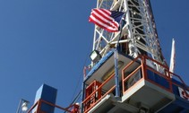 Oil rig with flag. Photo by USGS.