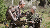 Father and son archery hunting. Photo by CDFW.