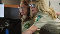 Dispatchers at the Federal Interagency Communication Center. Photo by Zach Behrens, USFS.