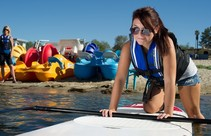 Paddleboarder wears life jacket at Lake Perris, part of the SWP. Photo by DWR.