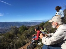 Volunteers taking in the view from South Cow Mountain. Photo by Ron McDonell, BLM volunteer.