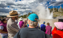 Visitors at the Yellowstone geyser. Photo by NPS.