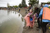 Little girl fishing. Photo by Rachel Leathe, Bozeman Daily Chronicle.