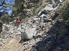 Hiker by a rockslide on the Pacific Crest Trail