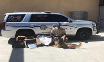 BIA Officer Jakson and K-9 Kofi with seized narcotics. Photo by BIA.