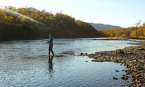 Woman fishing on Kodiak National Wildlife Refuge