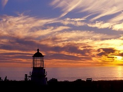 A light house during sunset.