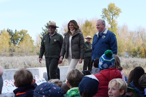 Acting Superintendent for Grand Teton NP Gopaul Noojibail, First Lady Melania Trump, and Interior Secretary David Bernhardt, walking.