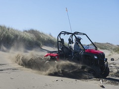 An off-highway vehicle in the sand dunes at Samoa Dunes.