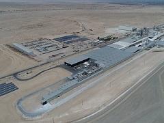 Aerial photo of mining complex in desert.