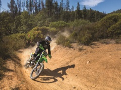 Dirtbike speeds around to turn at South Cow Mountain OHV recreation area.