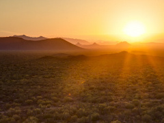 A photo of a sunset over the desert