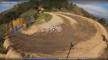 A still from a video of trail workers laying a bike trail.