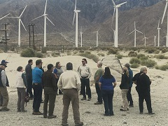 A photo of a group of people meeting in the desert.