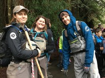 BLM and AmeriCorps employees in hiking gear.