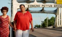 A photo of two ladies walking on Edmund Pettus bridge