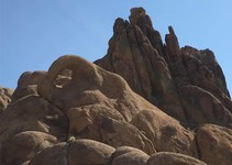 A photo of a rock formation set against a blue sky.