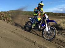 Dirt bike motorist in the desert.