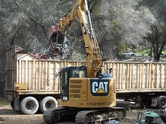Heavy equipment preforming cleanup operations.