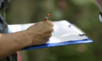 A photo of a person holding a clipboard.
