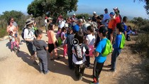 Video still of a BLM ranger with children on a guided hike.