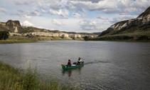 A canoe  boat in a lake.