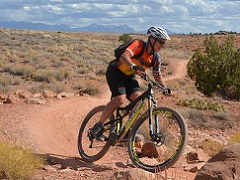Mountain biker riding on a trial in the desert.