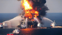 Offshore oil rig on fire.
