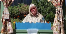 Ranger Tammy standing behind a miniature stage.