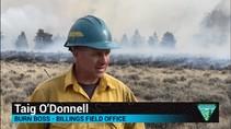 Video still of a firefighter speaking.