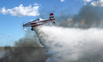A plane drops water on a wildfire in Everglades National Park.