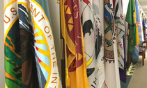 A hall lined with different Native American Tribes' flags.