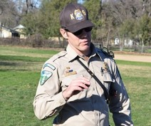 BLM Ranger with a dog.