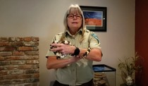 Ranger Tammy Holding a snake.
