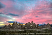 Rock formations in the desert during sunset.