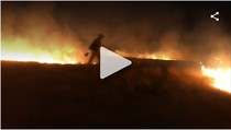 Video still of a firefighter.