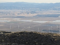An overview look of solar panels and wind turbines.