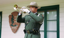 NPS police officer playing taps.