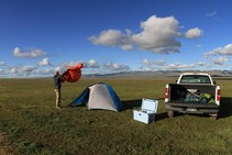 A camper setting up a tent.