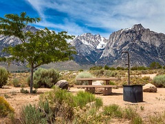 Campground with mountains in the background.