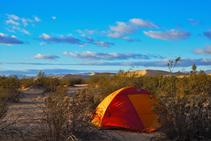A tent in a desert landscape.