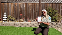 Ranger Tammy holding up an information card about insects.
