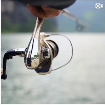 Video still of a fishing reel.
