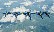 A photo of the blue angels squadron flying in formation.