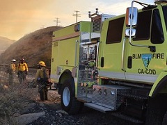 A BLM fire engine and firefighters.